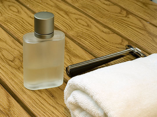 men's toiletries include cologne and a shaving razor